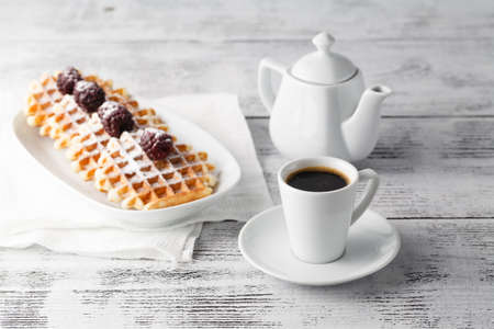 Few wafers on table with berries and coffee