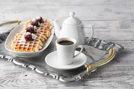 Brussels waffles with berries and coffee