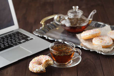 Breakfast for valentine day with tea and donut