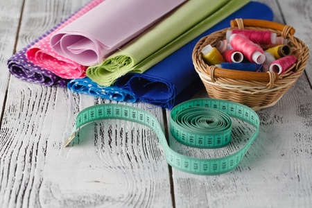 clothe: Home sewing hobby workplace with utencils on table