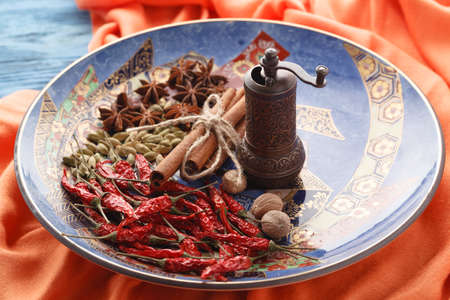 Closeup view of plate with orient spices on table
