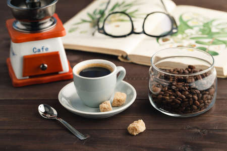 Coffee drinking concept. Rusted beans and cup on table Stock Photo