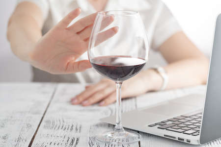 woman refuses to drink a wine