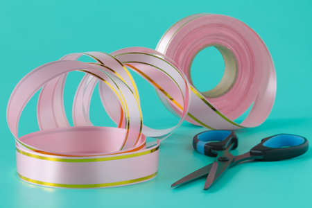Washi tape rolls, masking tape rolls in pile. Pink tones