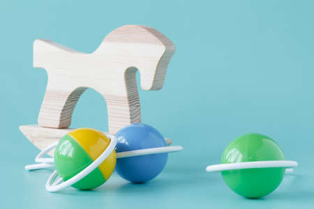 Wooden toy horse. Retro style. Light background. Stock Photo
