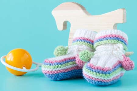 Cute toddler shoes on aquamarine background