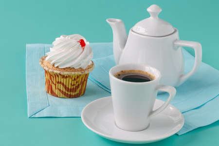 Black brewed coffee with ceramic utensils and sweets Stock Photo