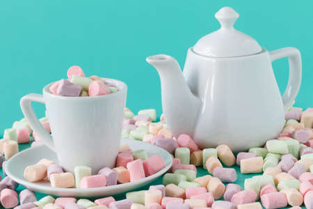 colorful fluffy marshmallows. Mockup white tea cup. Stock Photo