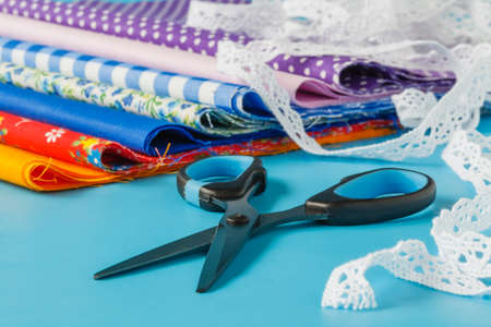 needle laces: Sewing and Needlework: thread, needles, lace, ribbon, scissors, cloth.