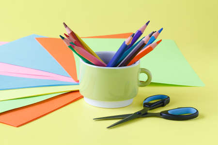 Childrens creativity, pencils, scissors, colored paper, there is a place for text