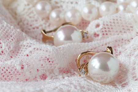 neckless: Background of white delicate lace fabric and pearls