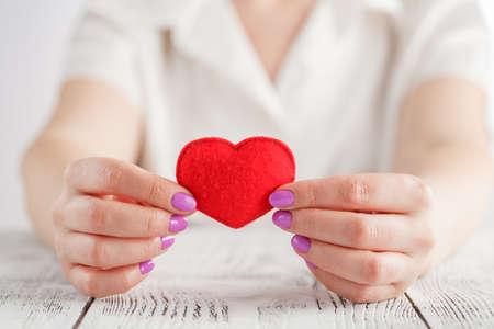 hands holding a soft heart shape Stock Photo
