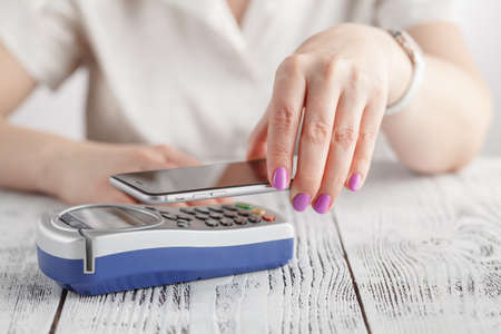 taker: Woman using NFC technology to make payment