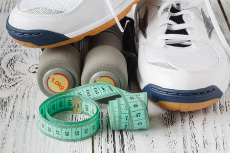get a workout: Stylish sneakers on wooden surface. Time for physical activity.
