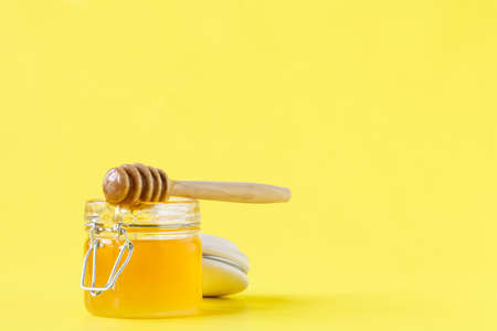 drizzler: Honey dropping from dipper into a jar