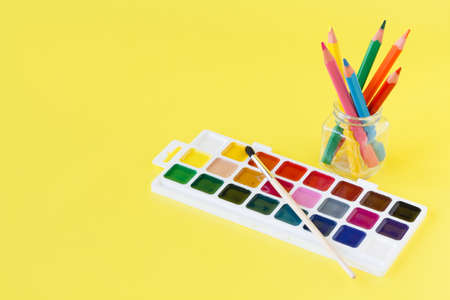 sample tray: Use watercolor paints box on yellow background Stock Photo