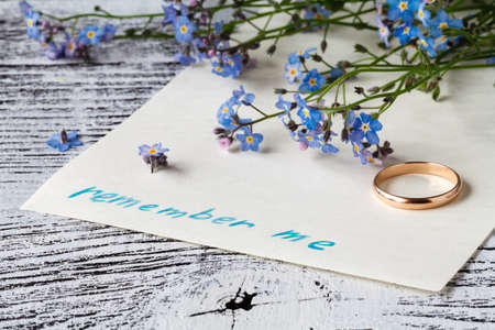 autograph: Forget-me-not flower on message note. alone concept