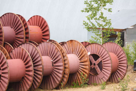 Blank big cable reels of metal for storing data cable.