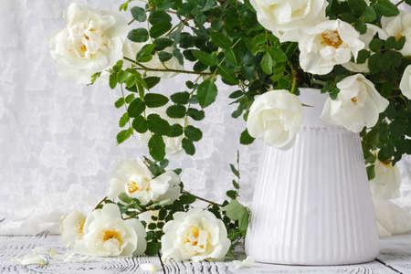 Beautiful rose in vase on wooden window