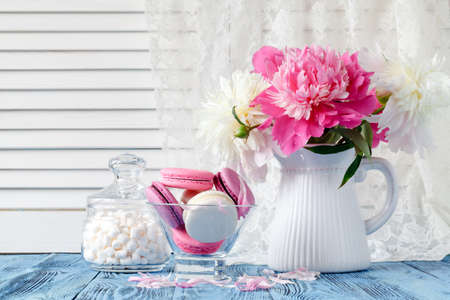 Bouquet of pink and white peony flowers on wall panelling background