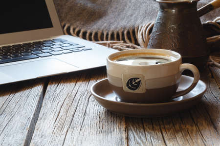 Laptop with coffee cup home office. Stock Photo