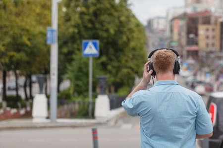 Head in silhouette with headphones Stock Photo