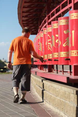 wheel barrel: Red prayer wheels in Buddhism