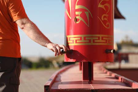 devote: Buddhist prayer wheels