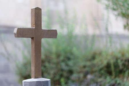 Single cross headstone in graveyard Stock Photo