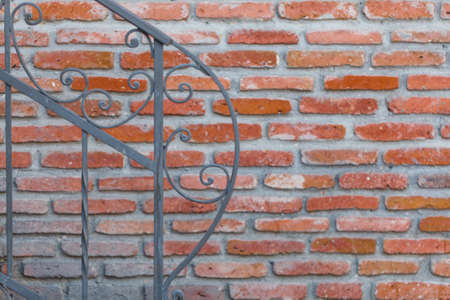 Ancient wall and sunlight. Cement and thin bricks Stock Photo