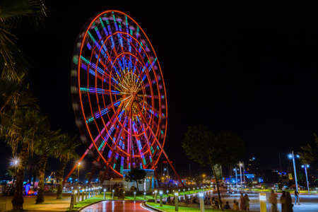 The bright ferris wheel is one of the most popular attractions in city