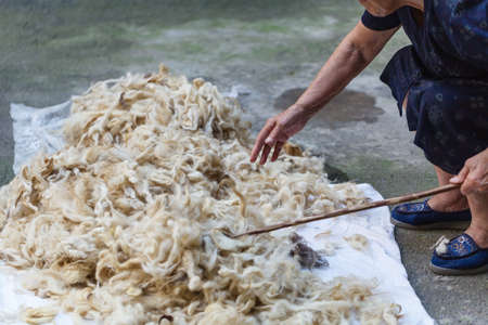 art processing: sheeps processing of sheeps wool traditional Stock Photo