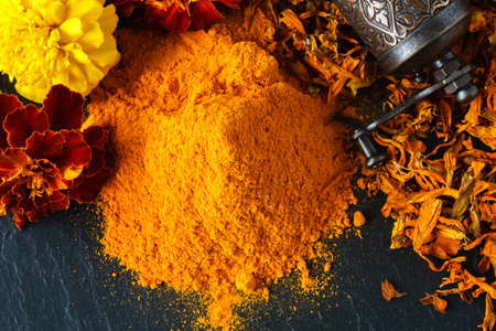 Colorful heap of spices. Aromatic landscape with seasoning. Paprika, turmeric, imbir, nutmeg Standard-Bild