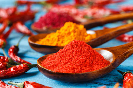 Spices. Spice in Wooden spoon. Herbs. Curry, Saffron, turmeric, cinnamon and other on a wooden rustic background