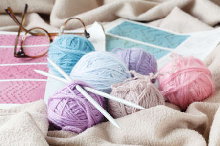 twist: Vintage Knitting needles and yarn on soft backgroundnatural wool knitting background