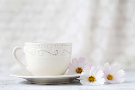cup of tea with flower on white Stock Photo