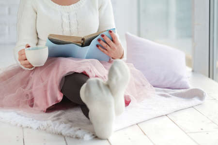 Woman with Cup tea Rest Plaid, Foot with White Socks Stock Photo
