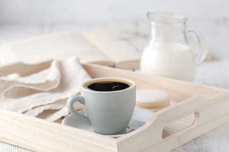 Home Interior with Coffee cup Books on table wooden tray