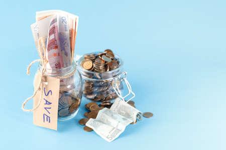 Money jar on blue background
