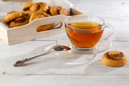 ware: cookies with cinnamon and tea on a table, selective focus, copy space