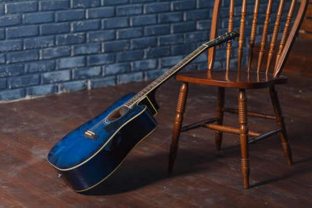 classic wooden guitar on chairs
