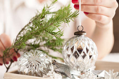 Christmas time decoration in female hand Stock Photo