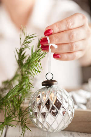 Closeup on christmas ball in hand of woman Stock Photo