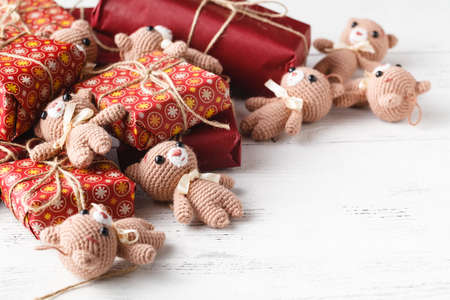 Cute teddy bear toys on a decorated gift boxes
