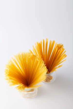 Heap of Pasta tied up by a rope isolated on a white background Stock Photo