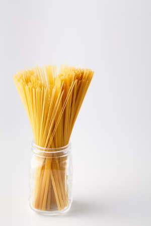 Spaghetti, twine bound, stand vertically isolated on white background