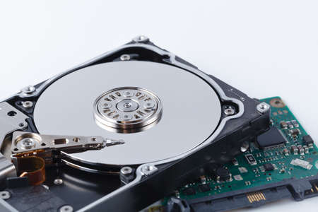 repair hard drive concept on white background with tools