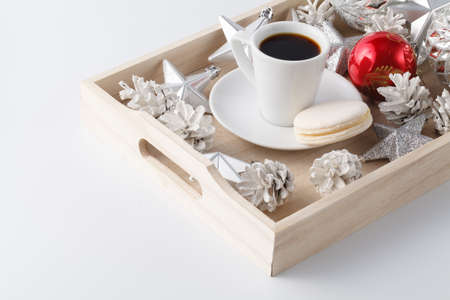 Christmas decoration and small cup of coffee on white
