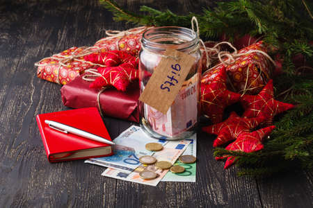Save money for christmas gift concept with glass jar