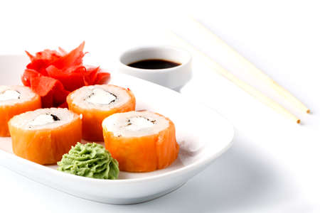 Traditional eastern dish with salmon sushi rolls on a white plate Stock Photo